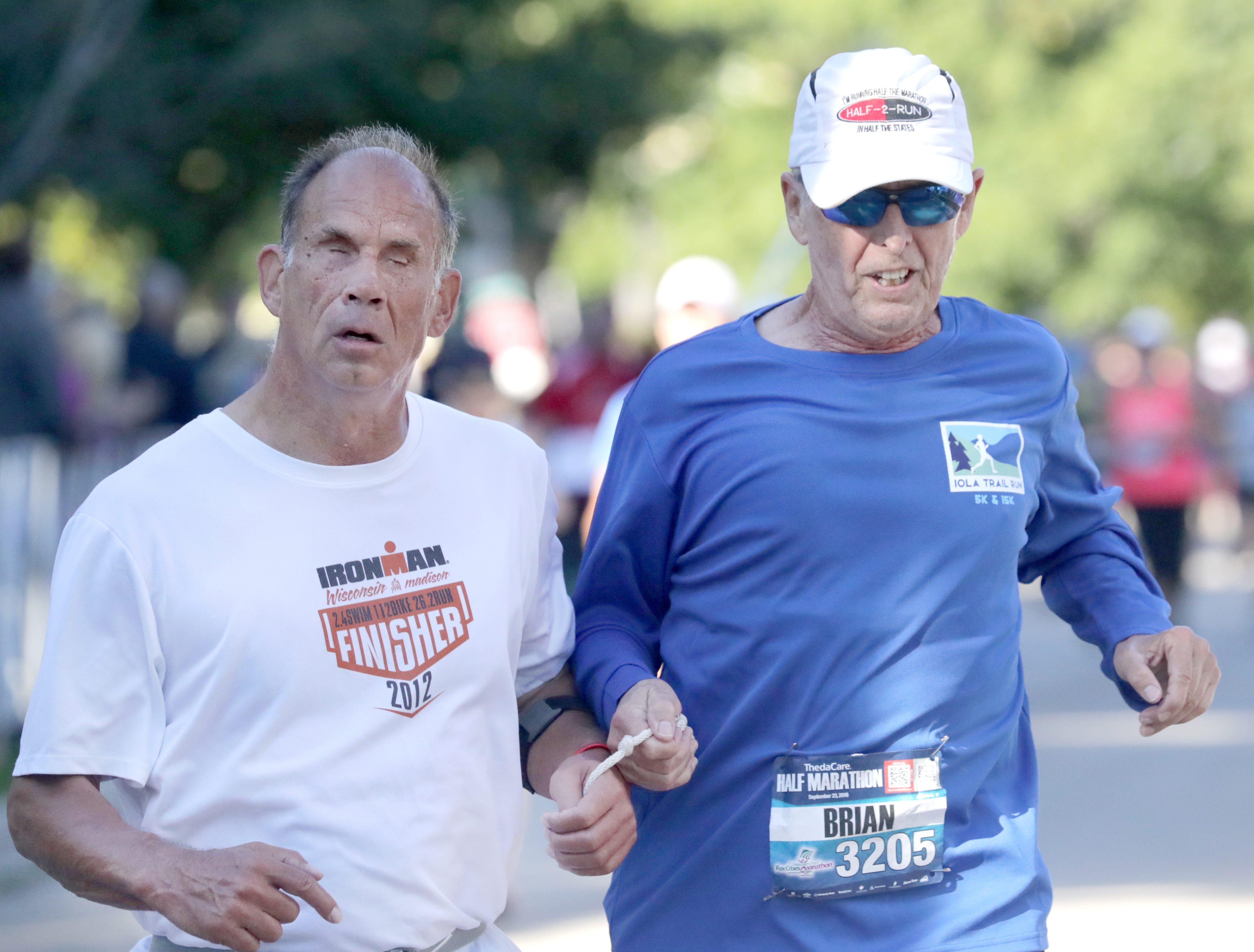 Rod Maccoux and Brian Christoffel cross the finish line in the half marathon event during the 28th annual Community First Fox Cities Marathon on Sunday, September 23, 2018, in Neenah Wis. Wm. Glasheen/USA TODAY NETWORK-Wisconsin.