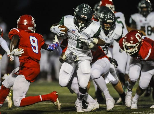 Long Branch junior running back Jermaine Corbett, shown running the ball last Friday night against Ocean, is one of the nominees in this week's Asbury Park Press Player of the Week Football Poll