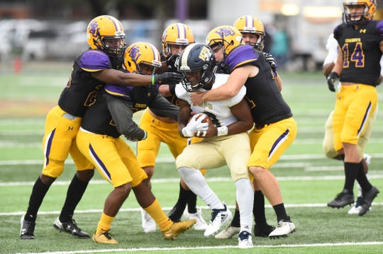 A host of Hardin-Simmons defenders bring down a Howard Payne ball-carrier at Shelton Stadium on Saturday, Sept. 22, 2018.