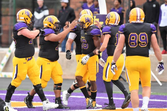 Hardin-Simmons offensive linemen congratulate Jaquan Hemphill (16) after his 58-yard touchdown run against Howard Payne at Shelton Stadium on Saturday, Sept. 23, 2018. The Cowboys won 65-14 behind four Hemphill scores.