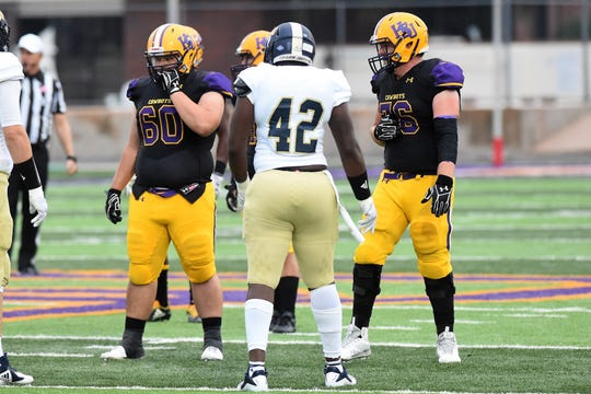 Hardin-Simmons offensive linemen Ben Donahue (60) and Patrick Riley (76) look for the play call against Howard Payne at Shelton Stadium on Saturday, Sept. 23, 2018.