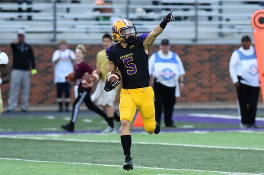 Hardin-Simmons' Reese Childress (5) points to the stands during his 60-yard punt return for a touchdown against Howard Payne at Shelton Stadium on Saturday, Sept. 22, 2018.