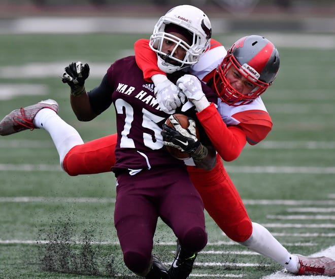 War Hawks wide receiver Spencer Knox is pulled out of bounds by Sul Ross' Isaiah Jacobs during Saturday's game in Abilene Sept. 22, 2018. McMurry won, 35-24.
