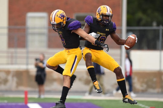 Hardin-Simmons running back Jaquan Hemphill (16) and Matthew Sandoval (4) celebrate a touchdown against Howard Payne during the 2018 season. It was the final full game Hemphill would play that year, suffering a shoulder injury the next week.