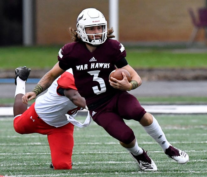 McMurry War Hawks quarterback Kevin Hurley, Jr. scrambles against Sul Ross in Abilene Sept. 22. McMurry won, 35-24.