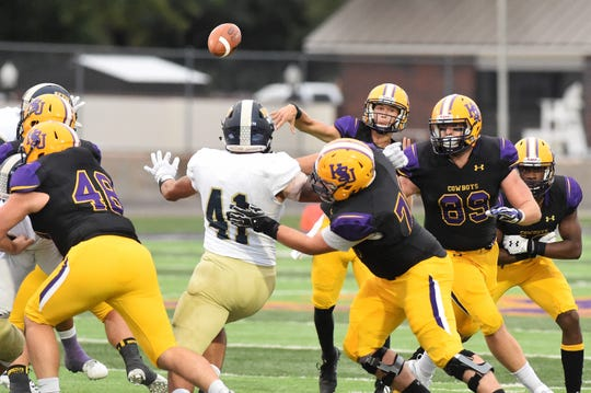 Hardin-Simmons quarterback Ty Hooper (12) throws a pass against Howard Payne at Shelton Stadium. Hooper threw for 274 yards and a touchdown and rushed for another score in the 65-14 win.