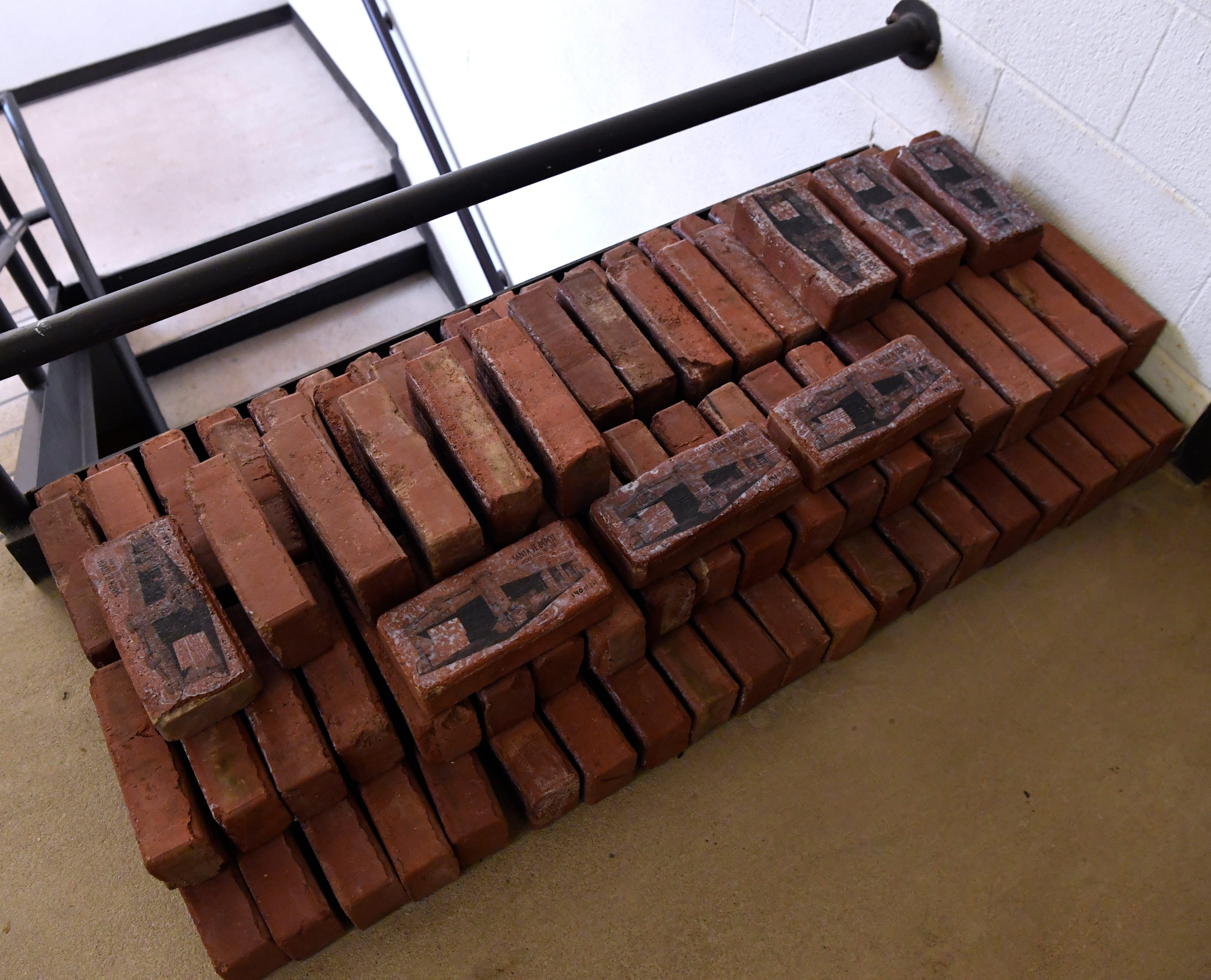Commemorative bricks from the Snyder Depot are stacked in the Scurry County Museum on Wednesday. The historical building was demolished in November 2017, the bricks are from the platform that surrounded it.
