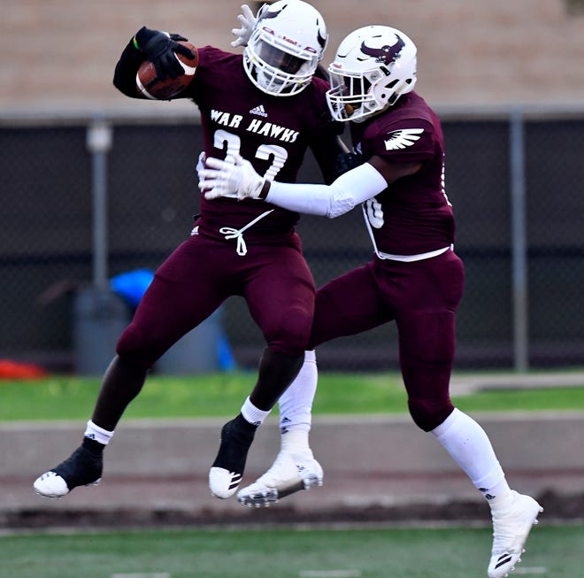 McMurry's Doyle Hughes (left) and Trevion Harris celebrate Hughes' touchdown against Sul Ross in Abilene Saturday Sept. 22, 2018. McMurry won, 35-24.