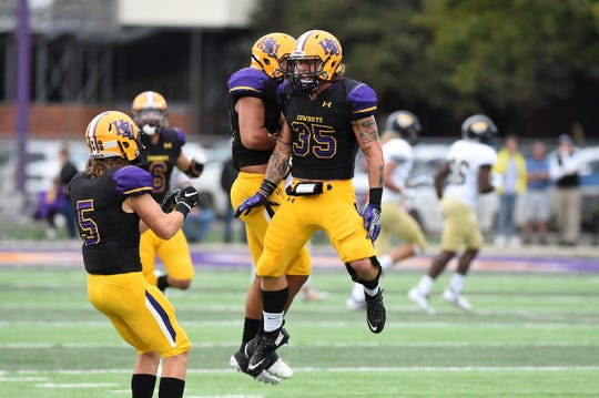 Hardin-Simmons linebacker Chris Miller (35) is congratulated by teammates for his blocked field goal against Howard Payne at Shelton Stadium on Saturday, Sept. 23, 2018.