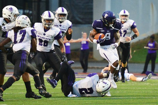 SFA's Remi Simmons (8) tries to get past ACU's Brandon Richmond after making a catch as the Wildcats' defense gives pursuit. SFA won the Southland Conference game 24-21 on Saturday, Sept. 22, 2018 in Nacogdoches.