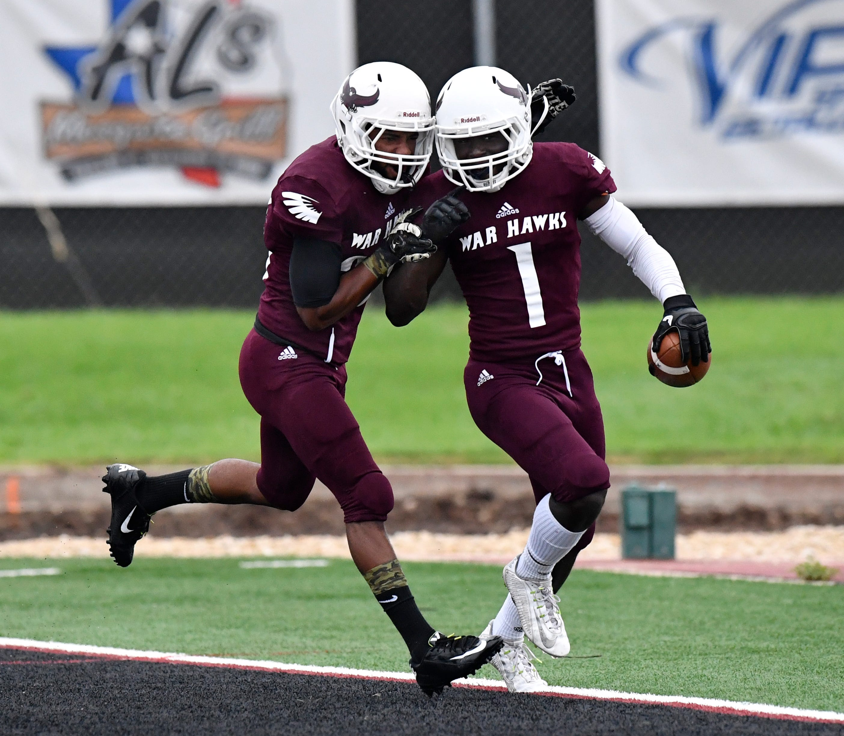 War Hawks wide receiver Spencer Knox (left) congratulates fellow McMurry wide receiver Eriel Dorsey on a touchdown against Sul Ross in Abilene on Sept. 22. The two players have been key to the McMurry passing attack.