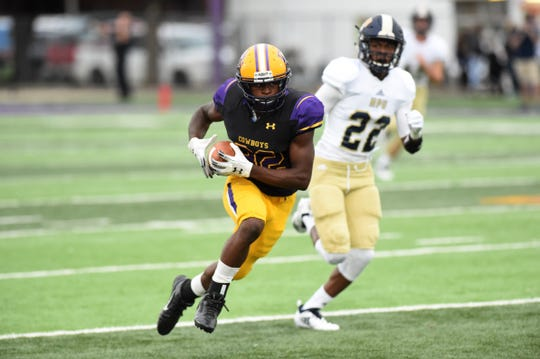 Hardin-Simmons receiver Kevi Evans (82) makes a big play against Howard Payne at Shelton Stadium on Saturday, Sept. 23, 2018. Evans had two catches for 121 yards in the 65-14 win.