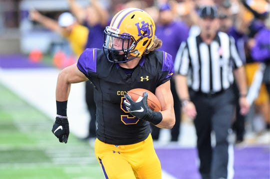 Hardin-Simmons receiver Reese Childress (5) looks to his right as he scores a touchdown against Howard Payne at Shelton Stadium on Saturday.