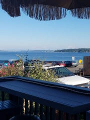 The sweeping view from Sully's patio includes the distant Seattle skyline.