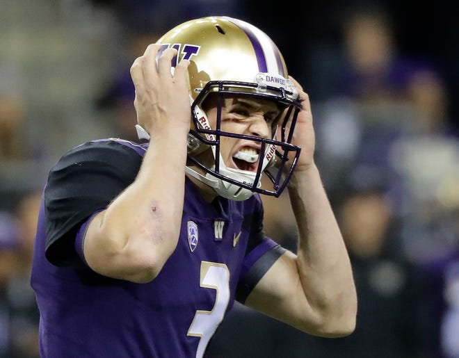 Washington quarterback Jake Browning calls out an audible to his team at the line of scrimmage.