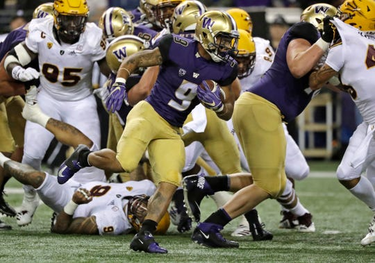Washington running back Myles Gaskin (9) looks for a hole in the Arizona State defense.