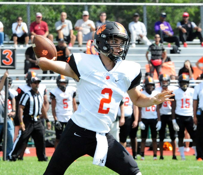 Woodrow Wilson quarterback Nick Kargman makes a pass against Cedar Creek during Saturday's football game in Egg Harbor on September 22, 2018.
