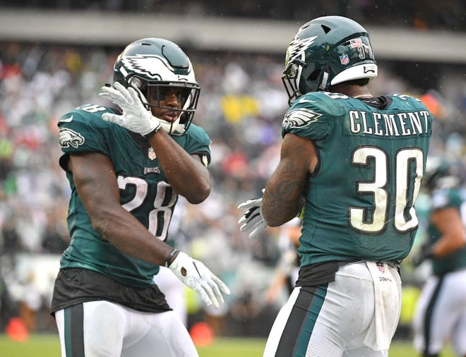 Eagles running back Wendell Smallwood (28) celebrates his 4-yard touchdown run with running back Corey Clement (30) during the fourth quarter of Sunday's 20-16 victory over the Colts.