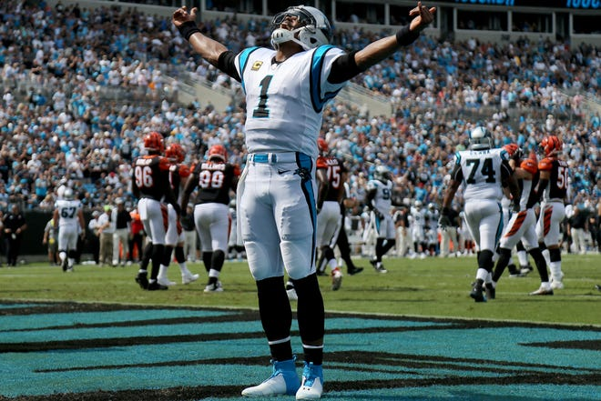 Carolina Panthers quarterback Cam Newton (1) celebrates a touchdown pass to Carolina Panthers wide receiver Devin Funchess (17) in the second quarter during a Week 3 NFL game between the Cincinnati Bengals and the Carolina Panthers, Sunday, Sept. 23, 2018, at Bank of America Stadium in Charlotte, North Carolina.