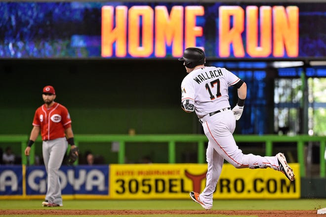 Sep 23, 2018; Miami, FL, USA; Miami Marlins catcher Chad Wallach (17) sounds the bases after hitting a three-run home run in the third inning against the Cincinnati Reds at Marlins Park. Mandatory Credit: Jasen Vinlove-USA TODAY Sports