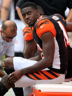 Cincinnati Bengals wide receiver A.J. Green (18), who suffered an injury, looks up at the scoreboard in the fourth quarter during a Week 3 NFL game between the Cincinnati Bengals and the Carolina Panthers, Sunday, Sept. 23, 2018, at Bank of America Stadium in Charlotte, North Carolina. Carolina won 31-21.