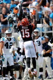 Carolina Panthers cornerback Donte Jackson (26) intercepts a pass intended for Cincinnati Bengals wide receiver John Ross (15) in the first quarter during a Week 3 NFL game between the Cincinnati Bengals and the Carolina Panthers, Sunday, Sept. 23, 2018, at Bank of America Stadium in Charlotte, North Carolina.
