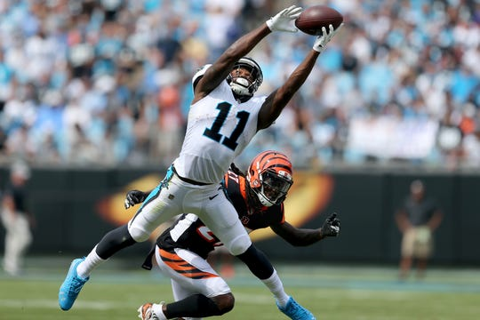 Carolina Panthers wide receiver Torrey Smith (11) completes a catch as Cincinnati Bengals defensive back Dre Kirkpatrick (27) defends in the first quarter during a Week 3 NFL game between the Cincinnati Bengals and the Carolina Panthers, Sunday, Sept. 23, 2018, at Bank of America Stadium in Charlotte, North Carolina.