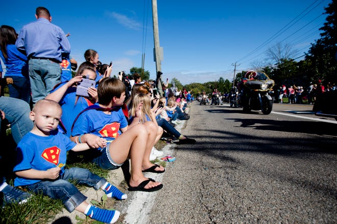 Brody Allen, 2, sits with his sister, Bailey, during the Christmas Parade for Brody in Colerain Township on Sunday, Sept. 23, 2018. Brody has been diagnosed with terminal brain cancer.