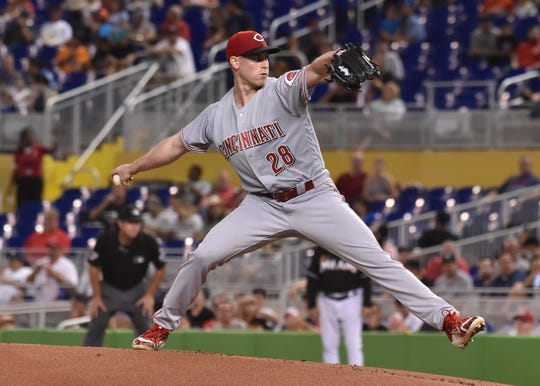 Sep 22, 2018; Miami, FL, USA; Cincinnati Reds starting pitcher Anthony DeSclafani (28) delivers a pitch in the first inning against the Miami Marlins  at Marlins Park. Mandatory Credit: Steve Mitchell-USA TODAY Sports