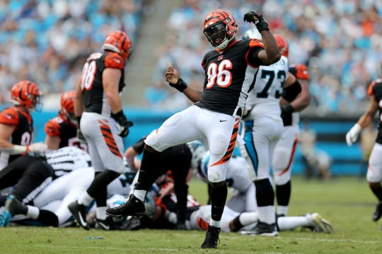 Cincinnati Bengals defensive end Carlos Dunlap (96) celebrates a forced fumble in the fourth quarter during a Week 3 NFL game between the Cincinnati Bengals and the Carolina Panthers, Sunday, Sept. 23, 2018, at Bank of America Stadium in Charlotte, North Carolina. Carolina won 31-21.