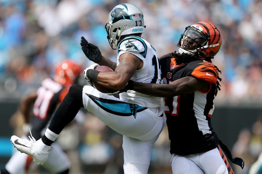 Cincinnati Bengals defensive back Dre Kirkpatrick (27) tackles Carolina Panthers wide receiver Jarius Wright (13) in the first quarter during a Week 3 NFL game between the Cincinnati Bengals and the Carolina Panthers, Sunday, Sept. 23, 2018, at Bank of America Stadium in Charlotte, North Carolina.