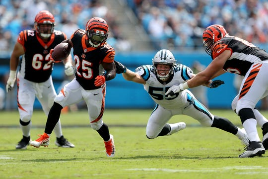 Cincinnati Bengals running back Giovani Bernard (25) escapes a tackle by Carolina Panthers linebacker David Mayo (55) in the second quarter during a Week 3 NFL game between the Cincinnati Bengals and the Carolina Panthers, Sunday, Sept. 23, 2018, at Bank of America Stadium in Charlotte, North Carolina.