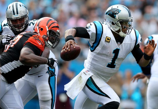 Carolina Panthers quarterback Cam Newton (1) escapes pressure from Cincinnati Bengals defensive tackle Geno Atkins (97) in the fourth quarter during a Week 3 NFL game between the Cincinnati Bengals and the Carolina Panthers, Sunday, Sept. 23, 2018, at Bank of America Stadium in Charlotte, North Carolina. Carolina won 31-21.