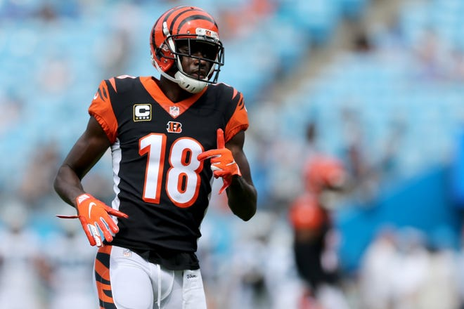Cincinnati Bengals wide receiver A.J. Green (18) warms up before a Week 3 NFL game between the Cincinnati Bengals and the Carolina Panthers, Sunday, Sept. 23, 2018, at Bank of America Stadium in Charlotte, North Carolina.