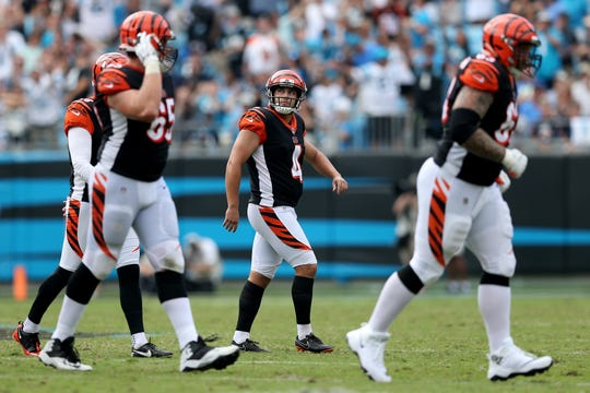 Cincinnati Bengals kicker Randy Bullock (4), center, walks off the field after a missed field goal attempt in the fourth quarter during a Week 3 NFL game between the Cincinnati Bengals and the Carolina Panthers, Sunday, Sept. 23, 2018, at Bank of America Stadium in Charlotte, North Carolina. Carolina won 31-21.