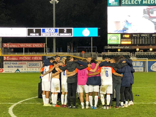 FC Cincinnati huddled and celebrated at midfield of FNB Field following Saturday's 2-1 victory against Penn FC. The win clinched home-field advantage throughout the USL Eastern Conference playoffs for Cincinnati.