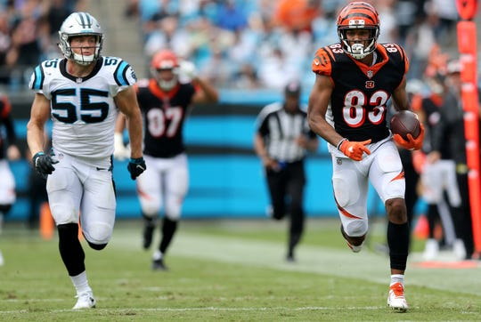 Cincinnati Bengals wide receiver Tyler Boyd (83) runs downfield for a long gain as Carolina Panthers linebacker David Mayo (55) gives chase in the fourth quarter during a Week 3 NFL game between the Cincinnati Bengals and the Carolina Panthers, Sunday, Sept. 23, 2018, at Bank of America Stadium in Charlotte, North Carolina. Carolina won 31-21.