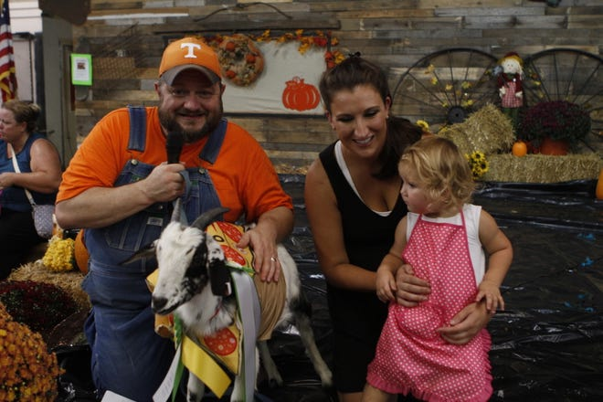Emcee Charles Martin posed with the 2018 King Puck winner Clancy, Kerri and Melanie Mitchum at the Houston County Fair.