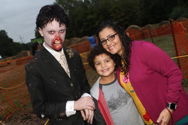 Photos with actors in zombie costumes and makeup were a popular sight during opening night.