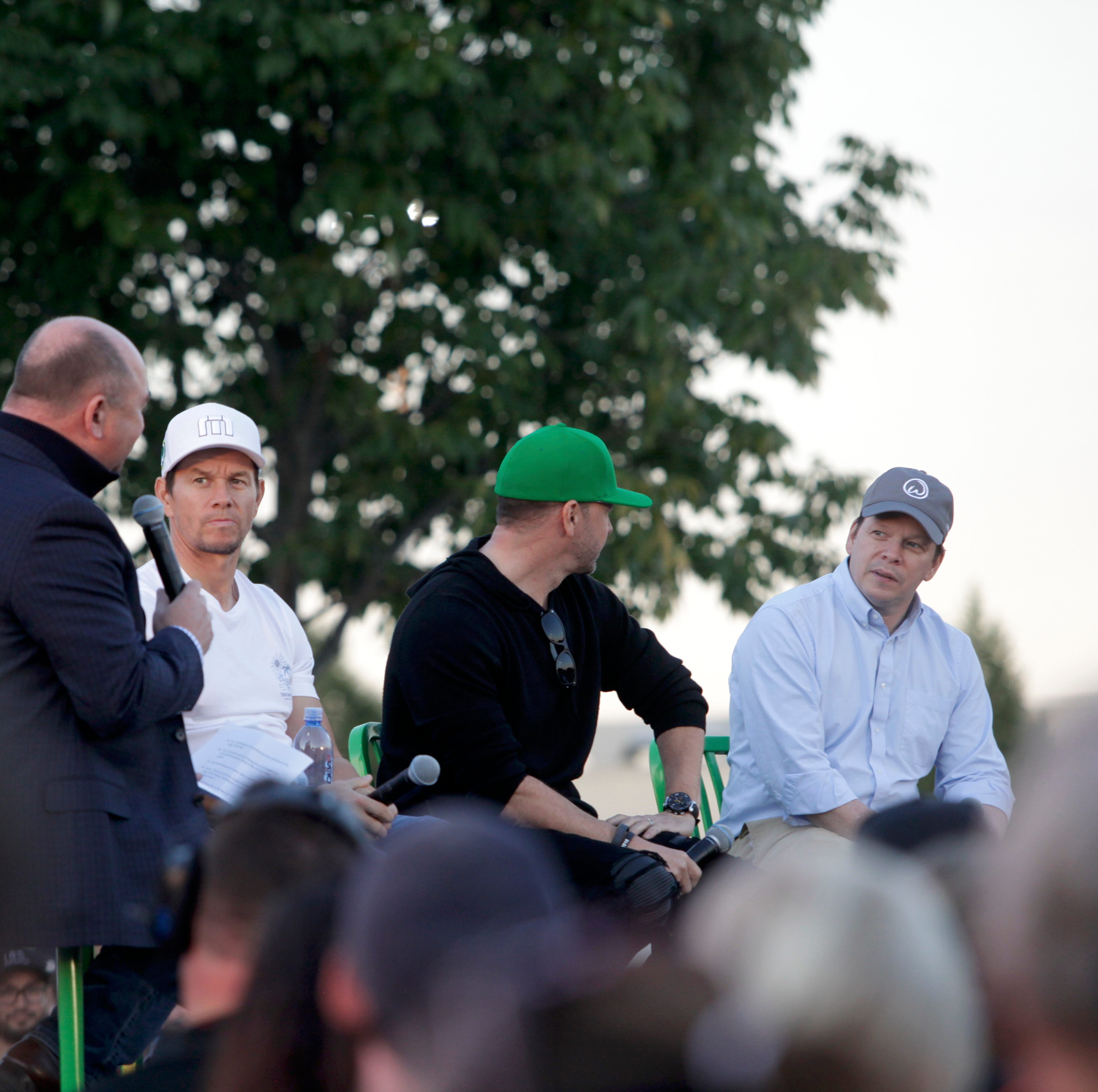 Mark, Donnie and Paul Wahlberg appeared in West Des Moines on Saturday night to promote a new location of their burger joint Wahlburgers.