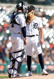 Tigers catcher Grayson Greiner meets on the mound with pitcher Daniel Norris during the third inning on Sunday, Sept. 23, 2018, at Comerica Park.