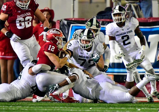 Indiana quarterback Peyton Ramsey is sacked by several Michigan State defenders, including Mike Panasiuk (72) during the second half Saturday, Sept. 22, 2018, in Bloomington, Ind. MSU won 35-21.