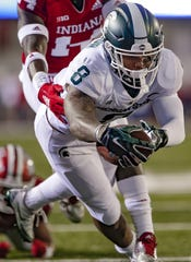 Michigan State's Jalen Nailor dives for a touchdown against the Indiana, Saturday, Sept. 22, 2018, in Bloomington, Ind. MSU won 35-21.