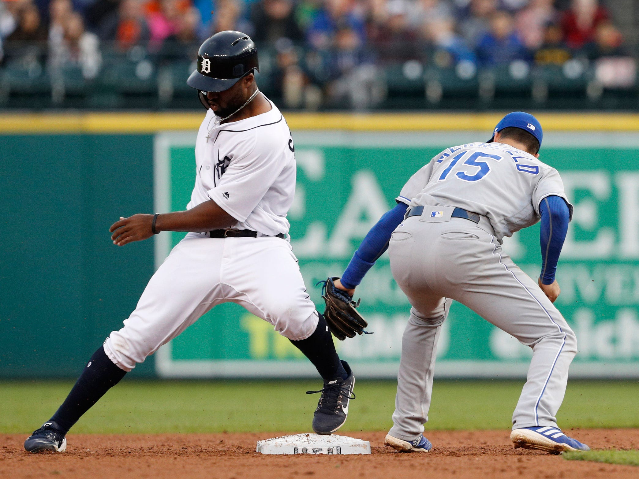 Kansas City Royals second baseman Whit Merrifield is unable to tag out Detroit Tigers left fielder Christin Stewart at second base during the third inning at Comerica Park  on Sept. 22, 2018.