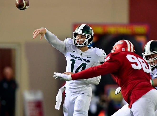 Brian Lewerke throws a pass against Indiana during the first quarter Saturday night.