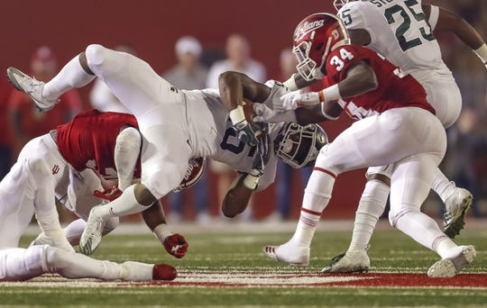 La'Darius Jefferson is tackled as Indiana's Cam Jones punches the ball out for a fumble during the first half Saturday.