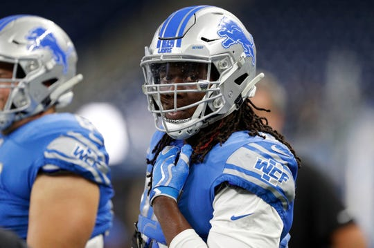 Detroit Lions defensive end Ziggy Ansah warms up before a game against the New England Patriots at Ford Field on Sept. 23, 2018. Ansah was inactive.