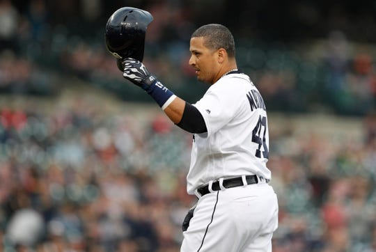 Detroit Tigers first baseman Victor Martinez raises his helmet and thanks the crowd as he walks off the field for the last time during the first inning against the Kansas City Royals at Comerica Park on Sept. 22, 2018.