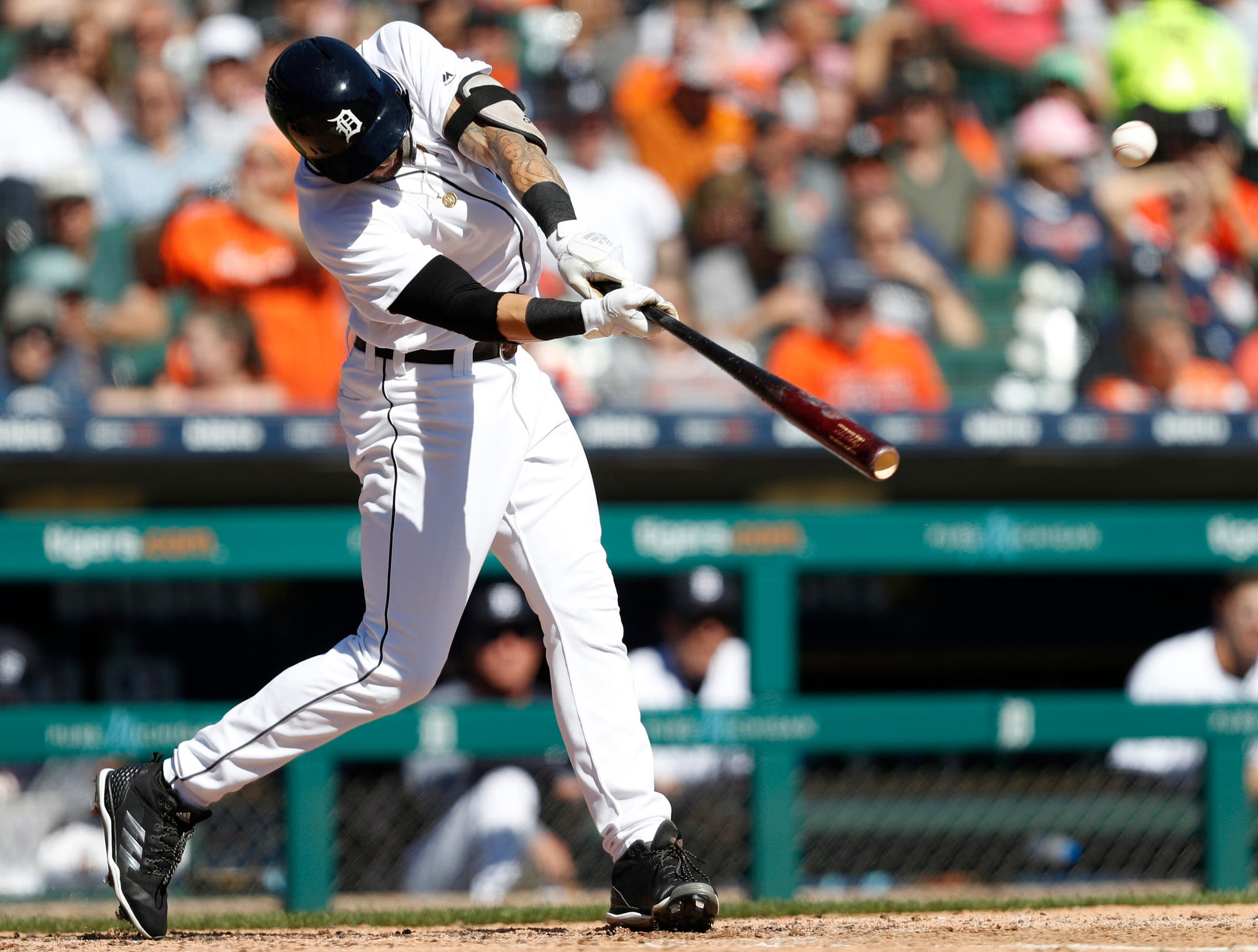 Tigers designated hitter Nicholas Castellanos hits a sacrifice fly RBI during the fourth inning on Sunday, Sept. 23, 2018, at Comerica Park.