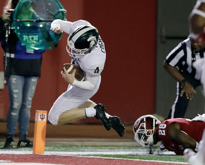 Michigan State kicker Matt Coghlin dives for a touchdown against Indiana's A'Shon Riggins during the second half Saturday, Sept. 22, 2018, in Bloomington, Ind. MSU won 35-21.